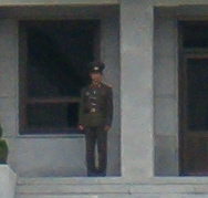 A North Korean soldier keeping a watchful eye on things (from a safe distance)