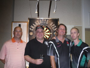 I had a big thrill last year at the Charlotte Open making it to the finals in the Friday night blind draw and playing on the Championship Board.  I had the good fortune of drawing John Liggett as a partner.  And the misfortune of playing against two highly ranked players (Chuck Pankow and Robbie Phillips).  Big time darts, big time fun!