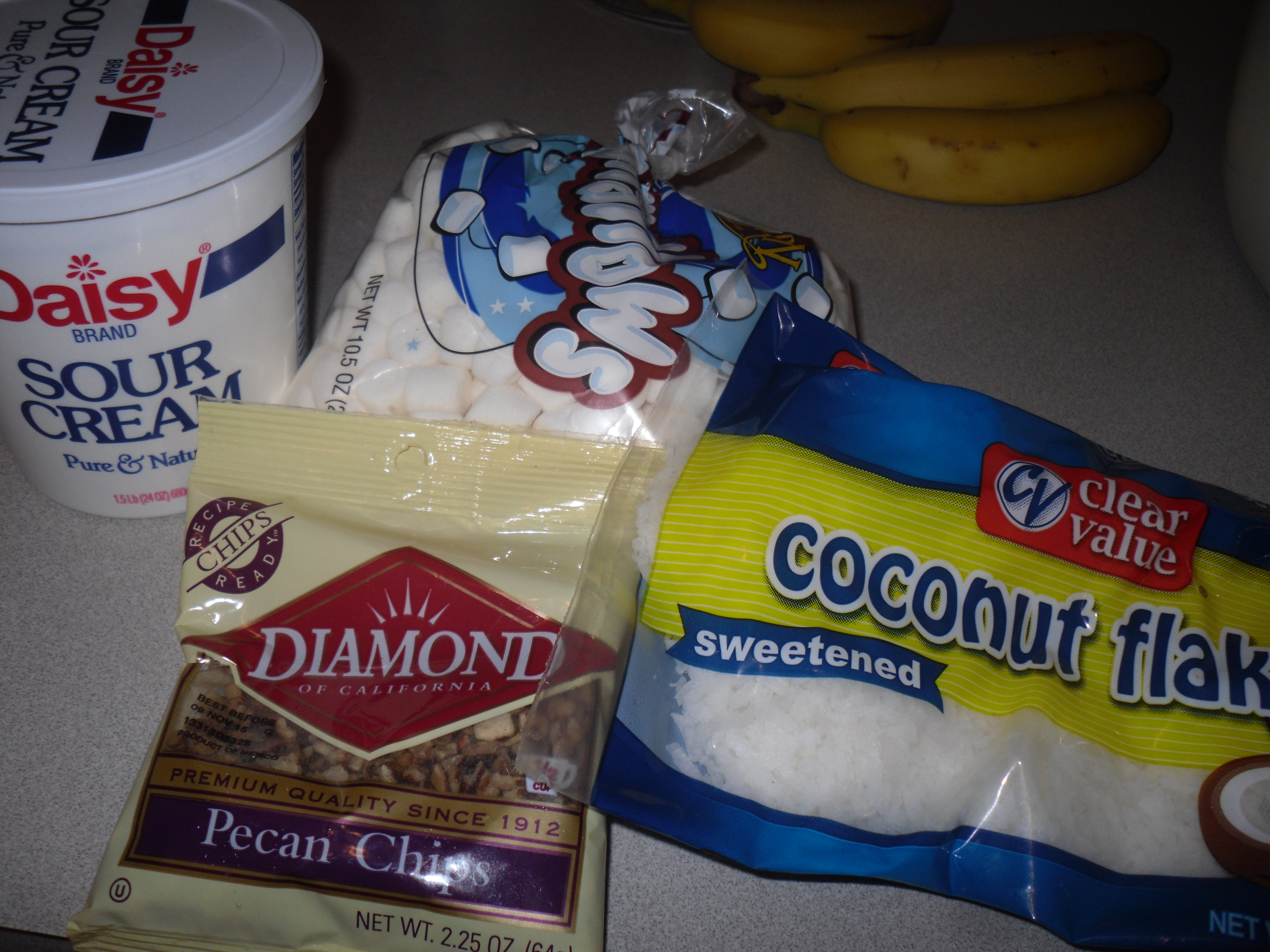 ...the remaining ingredients are sour cream, pecans, coconut and baby marshmallows...