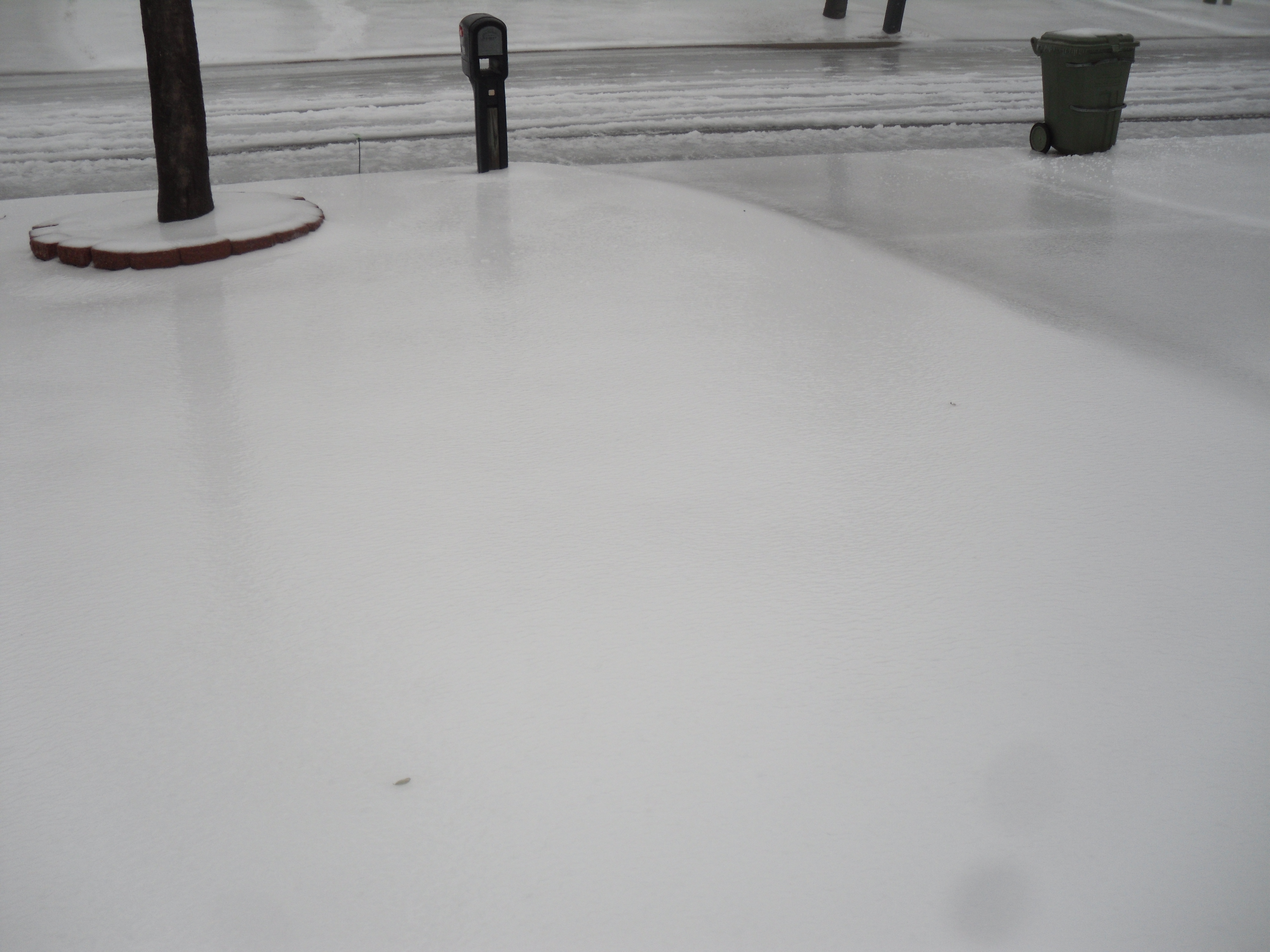 Today that snow base is covered with a sheet of ice.  Hard to get a good picture of it, but it's rock hard and slick as a skating rink.  I nearly fell on my ass several times in the process of taking this photo...