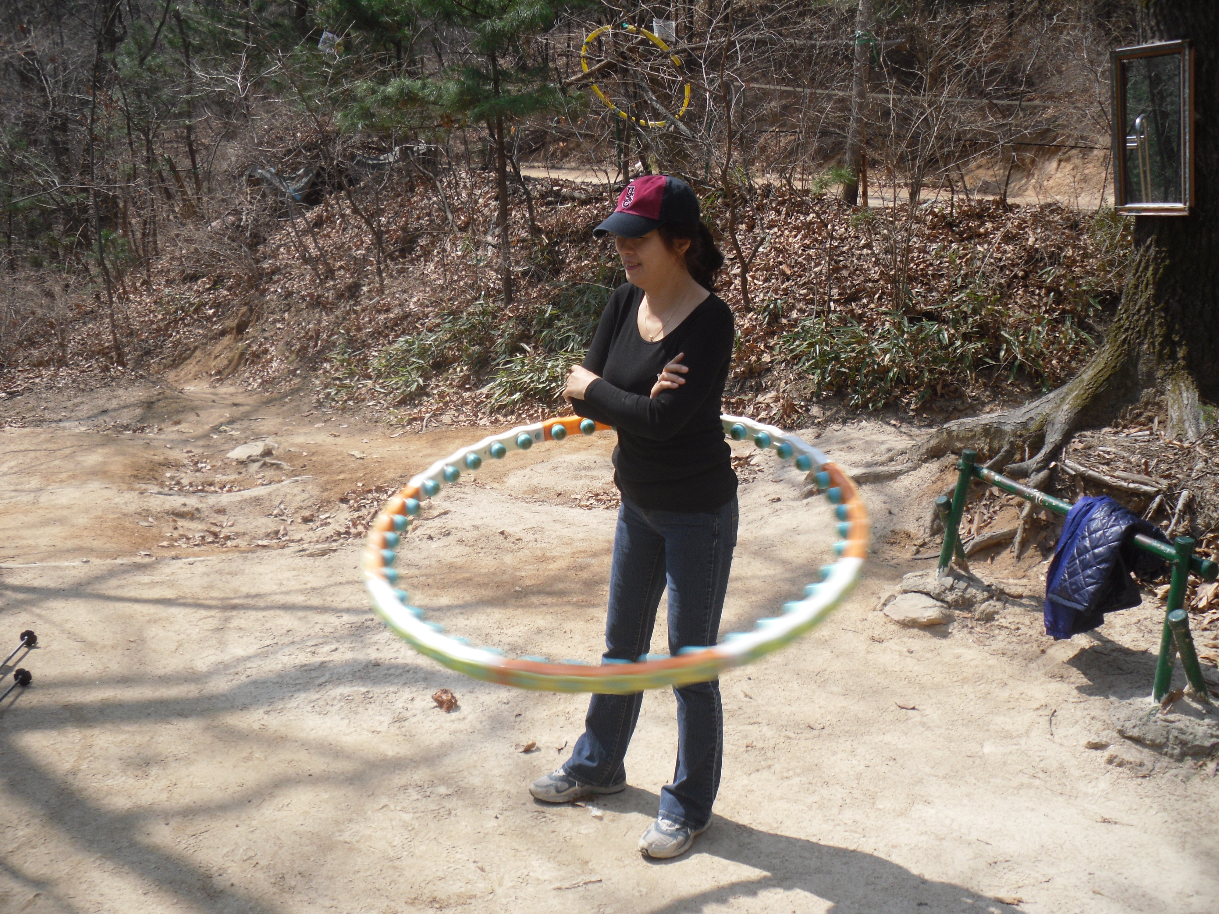 Jee Yeun loves to hula hoop.  The park conveniently keeps some laying about for like minded individuals.