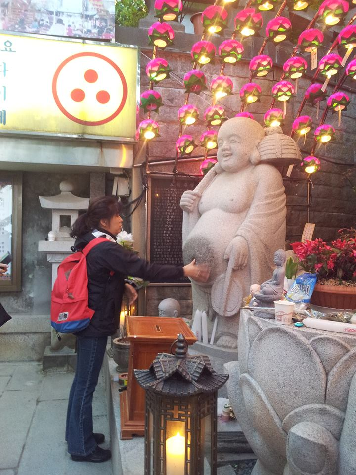 Jee Yeun rubbing the belly of the Buddha.  She used to rub mine like that...