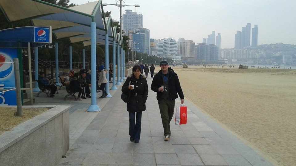 Down on the boardwalk.  Well, it was technically concrete, but you get the meaning.  Saturday had been nice, but Sunday morning was overcast and chilly.  We had planned on taking the boat to Taejongdae, but alas, there no longer is such a boat from Haeundae.  So, we took a cab instead.