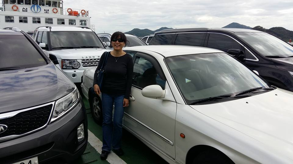 The journey even included a boat ride!  And there's my sad old car surrounded very expensive vehicles on the ferry.  But hey, my wife is hot!