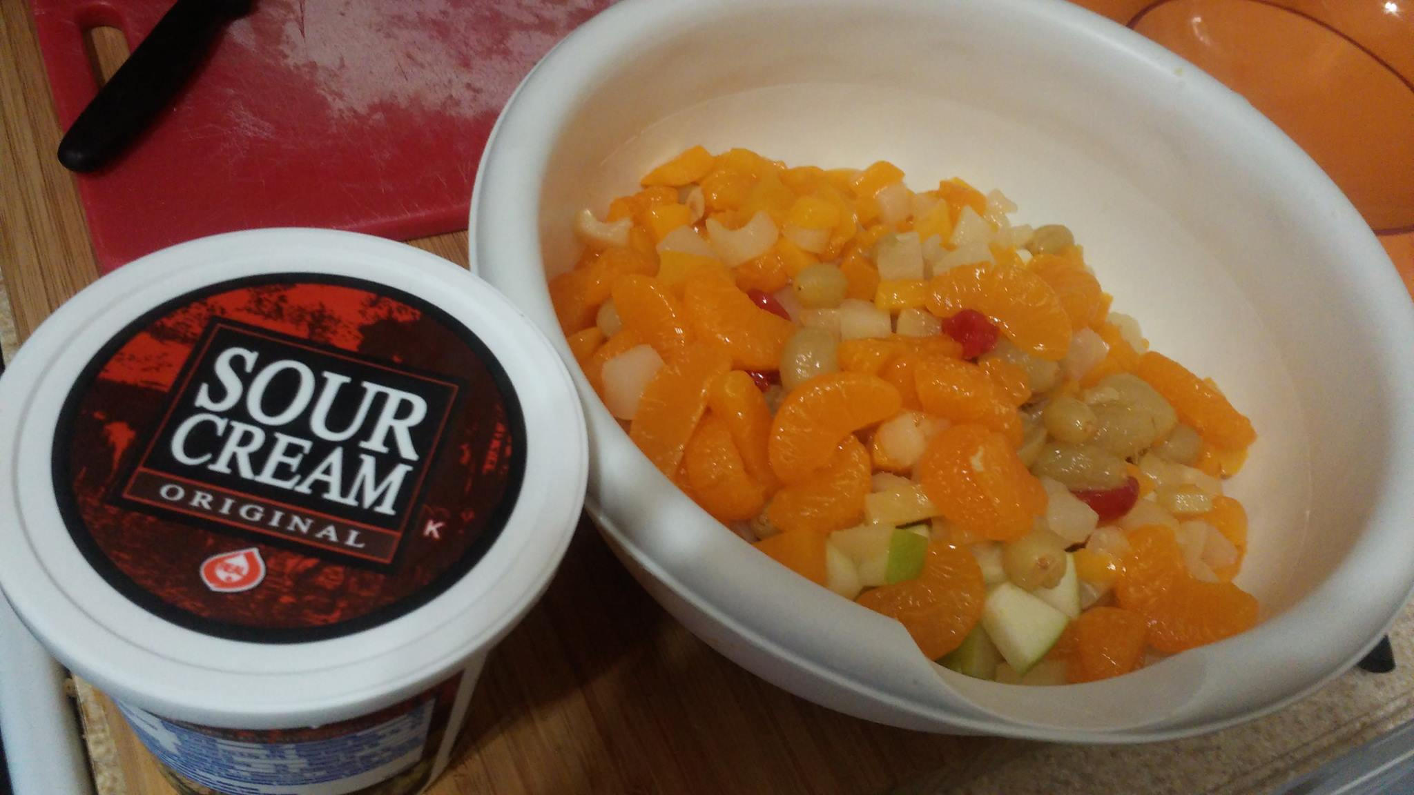 ...then I put all the fruit in a bowl and douse it with a large helping of sour cream...