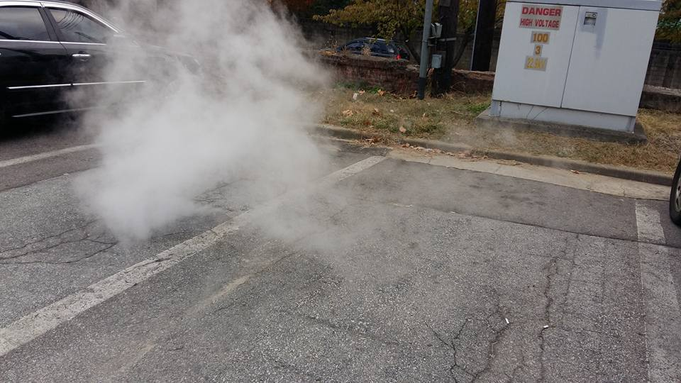 It was eerier in person.  Steam billowing right up out of the asphalt.  I guess they sent a work crew out and shut it down because it disappeared by the end of the day...
