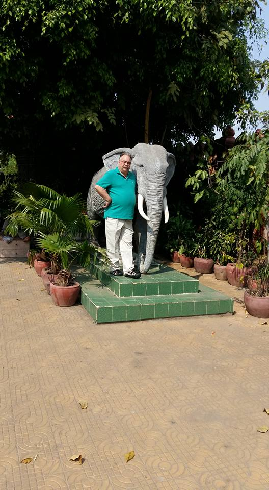 I had it in mind to pose with this elephant thinking that the contrast would make me appear smaller. You can see how that worked out for me..