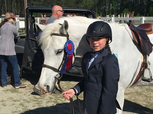 She loves horses and is a great rider, just like her mother at that age...